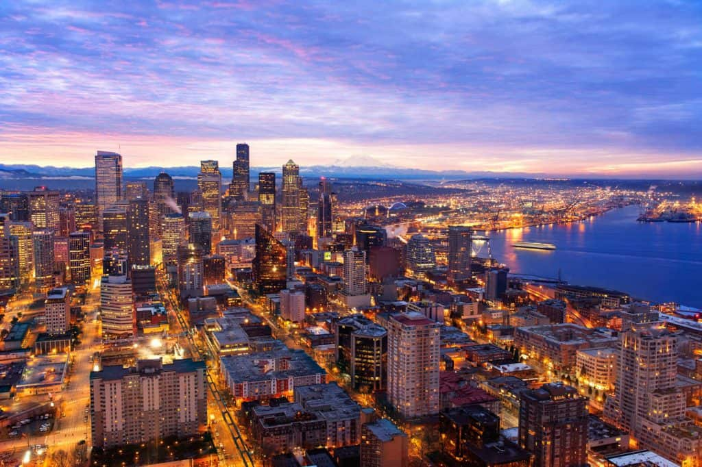 A cityscape of the Seattle, Washington skyline at sunrise.