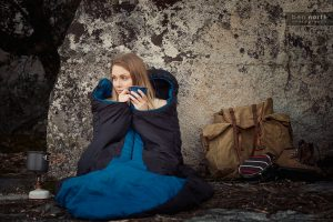 Outdoor Lifestyle Photoshoot - Woman drinking coffee on a backpacking trip.