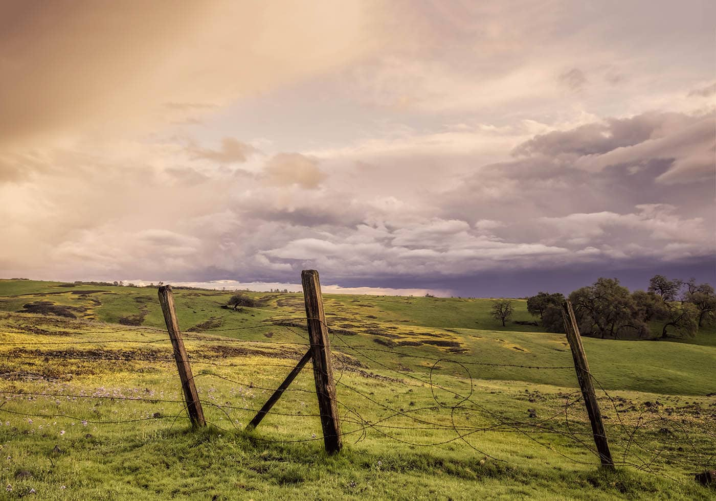 A broken fence on an old Ranch after a storm.