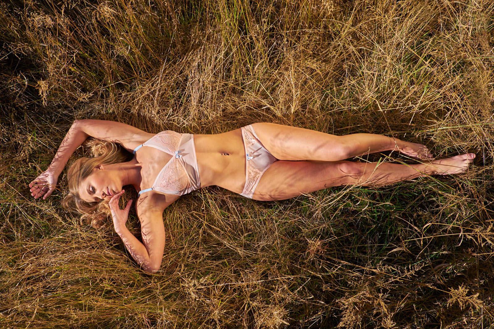Beautiful woman in lingerie outdoors enjoying the sun.