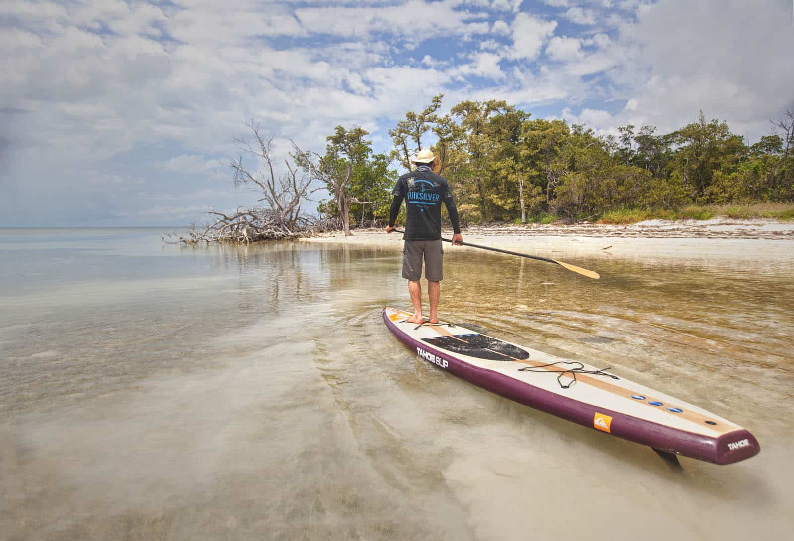 Justin Riney on his paddle board in Key West, Florida.