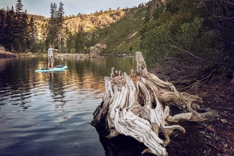 Fly fisherman on a mountain lake.