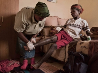 Home care volunteer working with a client in Swaziland