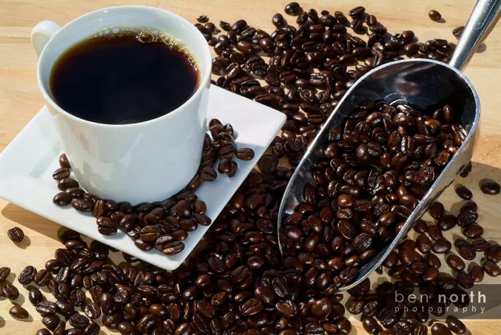 Coffee beans, coffee and a scoop