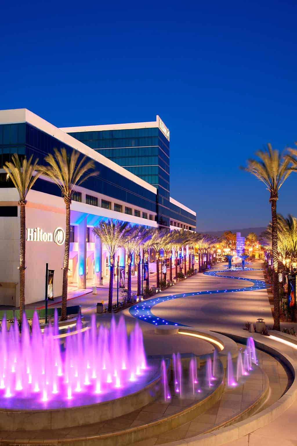 The Anaheim Hilton Hotel at Night with the new fountain in the foreground.
